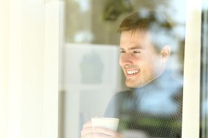 Happy man holding a coffee