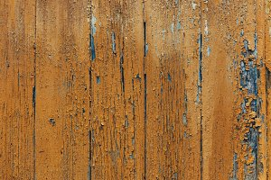 Old painted wood background. Close up of wood painted with oil paint.