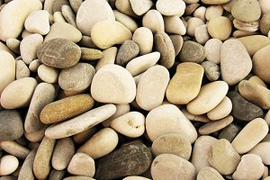 Pebbles on the sea shore background photo