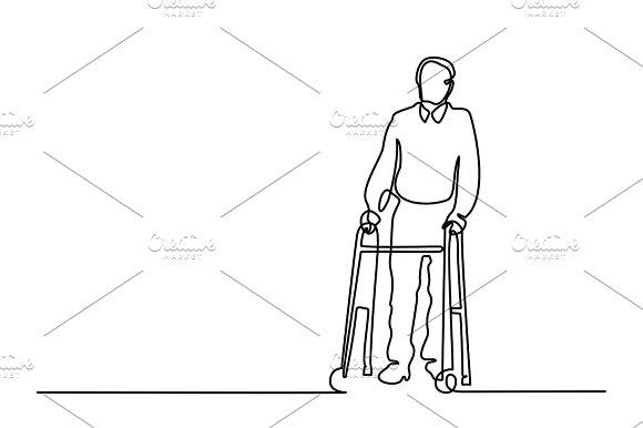 Old man using walking frame