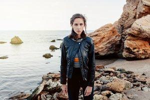 pretty brunett woman in black leather jacket
