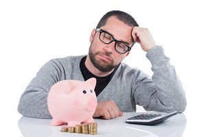 Man with piggy bank unsatisfied