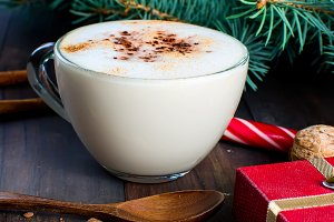 Cup hot latte with cinnamon