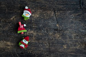 Christmas symbols on wooden background