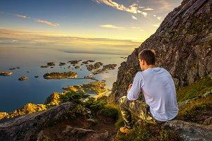 Hiker on the trail to mount Festvagtinden on Lofoten islands in Norway