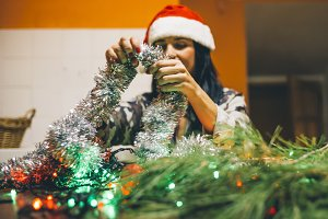 Woman creating Christmas decorations