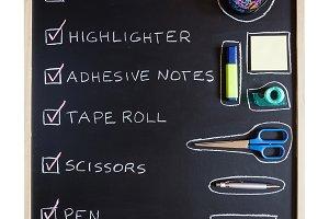 School supplies over blackboard