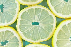 Lemon slices blue / green background