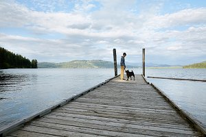 Young man and his dog at the lake