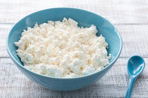 Organic Farming Cottage cheese or Curd Cheese in a blue bowl