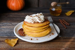Pumpkin pancakes with whipped cream