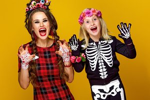 mother and daughter in halloween costume frightening