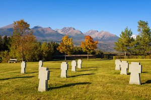 German military cemetery in autumn with mountains in the background