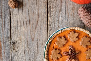 Pumpkin pie on old wood and copy space for text