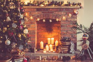 Christmas decorated room with fireplace and candles