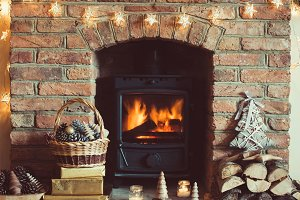 Christmas fireplace with logs and wooden ornaments