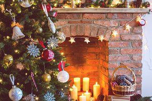 Christmas setting, candles, christmas tree, brick fireplace