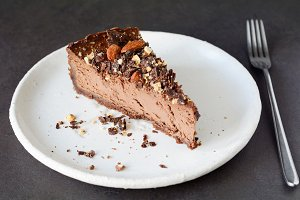 Chocolate cheesecake slice on white plate