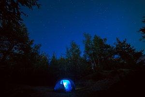 Tent under star sky