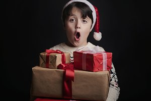 happy child with gifts at christmas