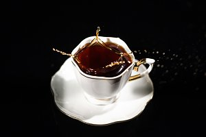 Coffe splashes in white cup