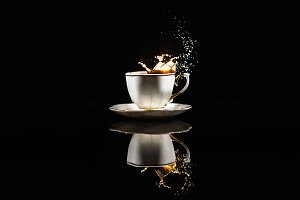 Coffee splashes in white cup