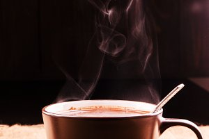 Aroma raises over a cup of coffee