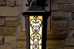 Lantern on a brick wall