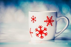 Mug with red snowflakes at blue
