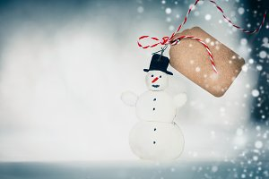 Handmade snowman with tag