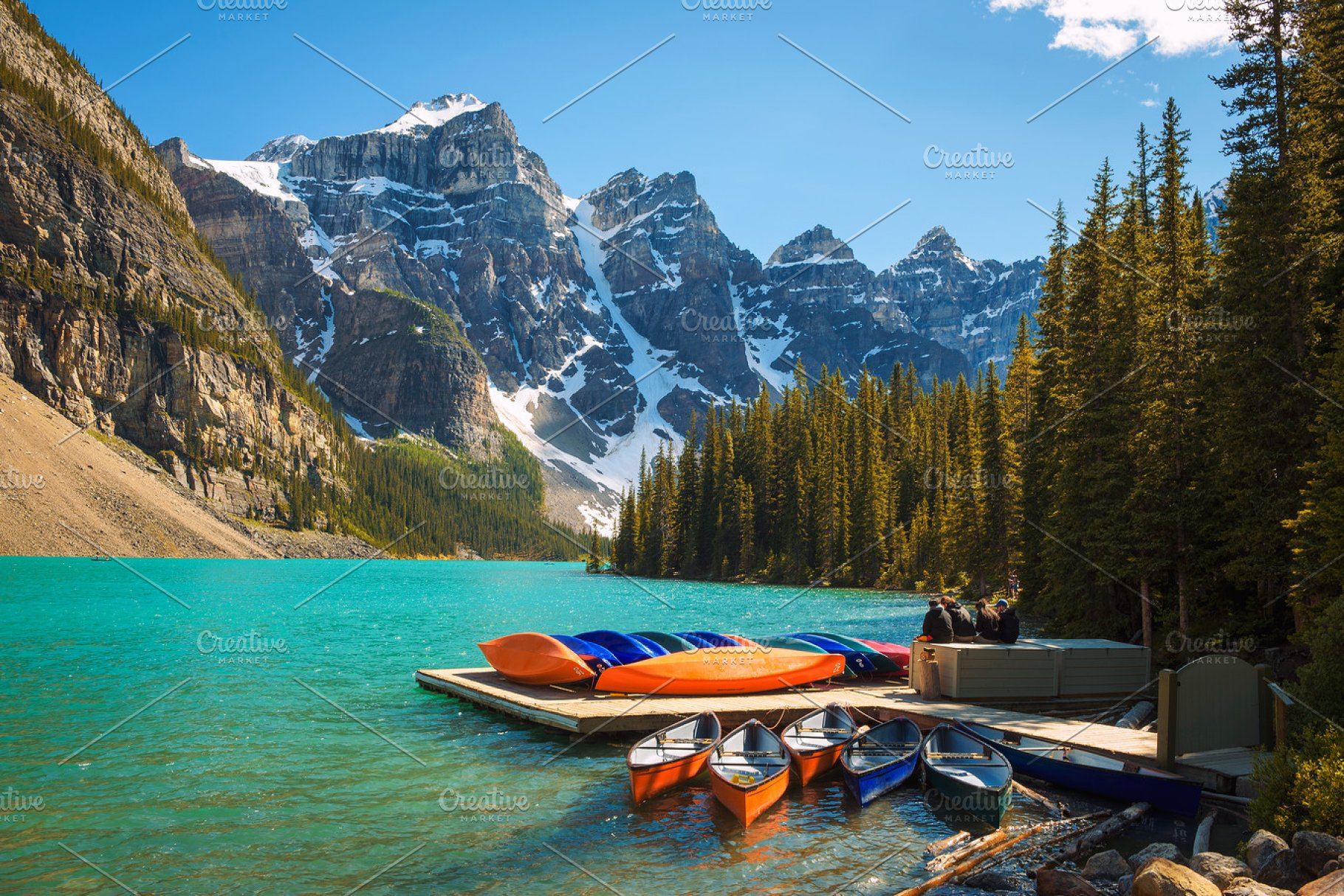 Canoes On A Jetty At Moraine Lake In Banff National Park Canada