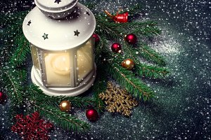 Lantern and Christmas tree branches on a dark background