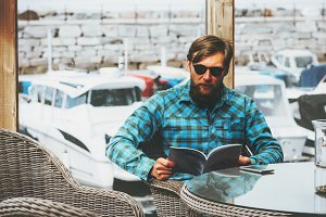 Bearded man reading journal