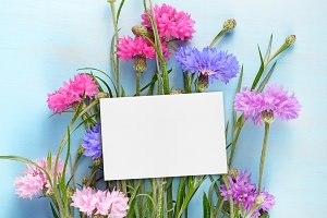 Blank birthday card and cornflowers