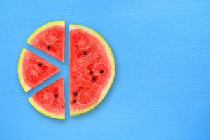 Watermelon slices on blue table
