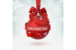 Christmas sale, decoration with red bow and ribbon around, on winter background.