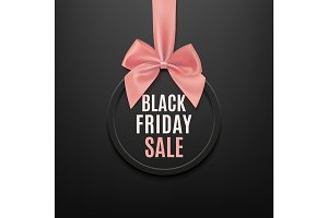 Black Friday round banner with pink ribbon and bow.