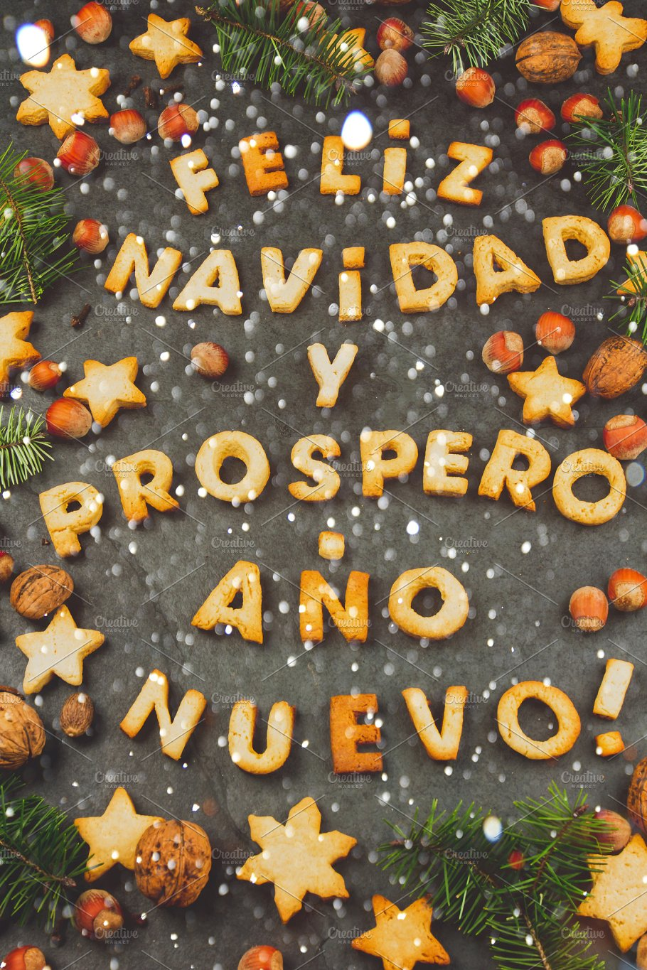 words text merry christmas and happy new year en spanish with baked