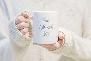 Mug mockup - woman in white jumper