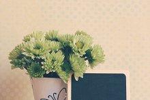 Blank blackboard with flower