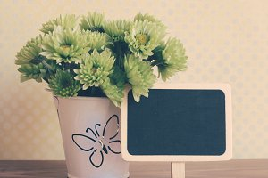 Blank blackboard with flower