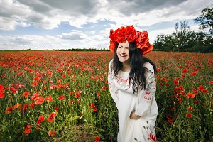 Pregnant woman on poppy field