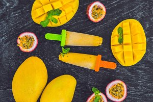 Homemade ice cream from mango and passion fruit. Popsicle