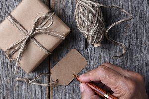 Man Writing Christmas Gift Tag