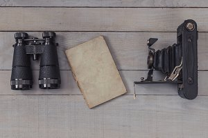 Antique binoculars and camera