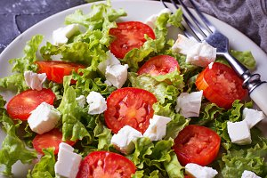 Healthy salad with tomato and feta cheese