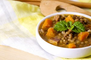 Lentil casserole on wooden table on yellow tablecloth