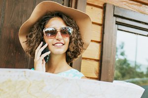 girl's travel map and mobile phone