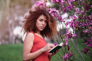smart afro woman holding a book