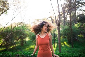 cheerful black afro woman outdoors